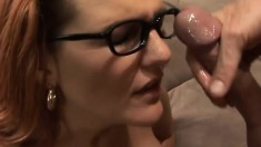 Horny MILF with glasses shows off her huge breasts while banging