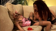 Two exciting milfs get together on the sofa and have fun with sex toys