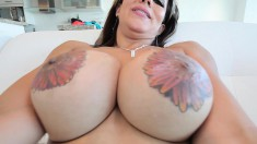 Big breasted shemale enjoys showing off her juicy inked knockers