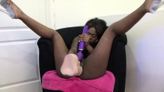 Black beauty spreads her legs and stuffs a huge dildo deep in her twat
