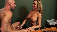 Brandi Love wraps her lips around his cock and sucks it down