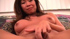 Big breasted Oriental milf shows off her curves and engages in hot sex