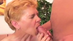 Short haired granny gives a nice blowjob and receives a deep pounding
