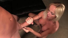 Delightful blonde strokes a big pole until it explodes with pleasure