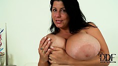 Chubby brunette milf reveals her huge natural boobs and her big round butt