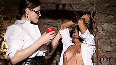 She doesn't mind being restrained, but the hot wax makes her nervous