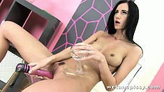 She toys her twat while sipping on her pee and then fingers it