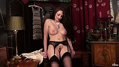 This plump brunette bimbo looks stunning in her lacy garter belt
