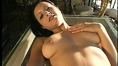 Alluring brunette with marvelous tits and ass Kristina pleases herself with a dildo