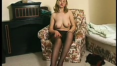 Naughty blonde with big boobs rips her black pantyhose and fingers her shaved pussy