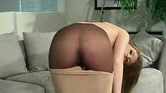 Petite cutie Faye Reagan rubs herself through her tight pantyhose