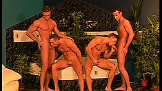 Four hunky studs with amazing bodies share hot kisses and bang each other's asses