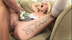 Inked up schoolgirl goes spread eagle to take a rough gangbanging