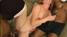 Skinny slut goes for two huge black cocks from guys in masks and gets a facial