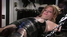 Cross Dresser has his nipples clipped and is tied down with plastic wrap