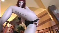 Skinny redhead Justine Joli rips her pantyhose and pleases her snatch