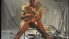 Fur clad black strongman rubs his shaft to a happy explosion