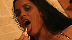 Exciting brunette with big tits uses a dildo to make herself cum hard