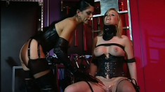 Blonde Anna Mills is at her mistresses' whim and gets fingered hard
