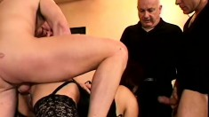 Lustful redhead lady has two studs banging her twat right in front of her husband