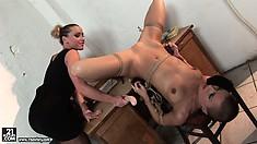 Petite cutie gets hung upside down by a dominant brunette slut