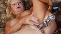 Mature housewife Irena uses her striped dildo to fuck herself
