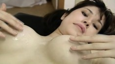 Sexy Japanese babe gets nailed from behind and jacks him off on her tits