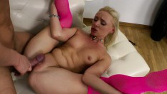 Pretty blonde in pink stockings gets her ass nailed in every position