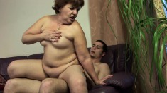 Mature granny gets a young man to blow and drill her in the cunt