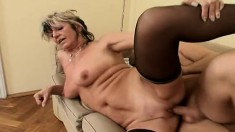Wild milf in black stockings hangs on for a deep banging on the couch
