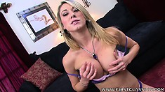 Voluptuous blonde with huge tits Amber Ashlee wraps her lips around a big cock