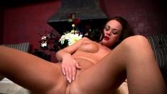 Horny babe enjoying solo masturbation in nylons