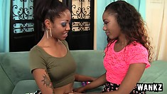 Enchanting black beauties Lotus and Chanell Heart have hot lesbian sex
