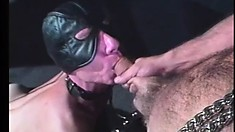 Guy in gimp mask fucks a blonde twink ass before taking an oral load